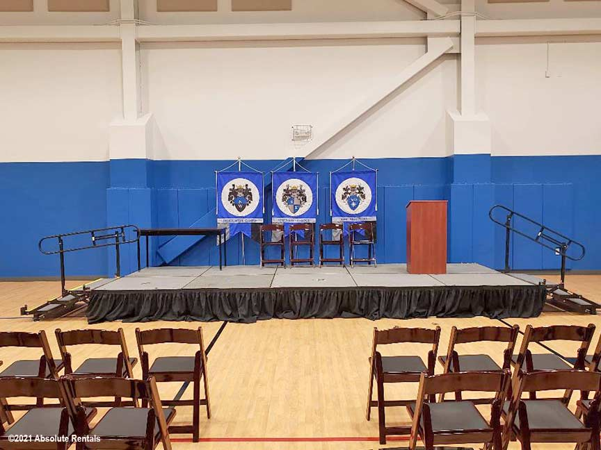 The School Graduation Setup features an 8x20' stage and comfortable mahogany padded chairs.